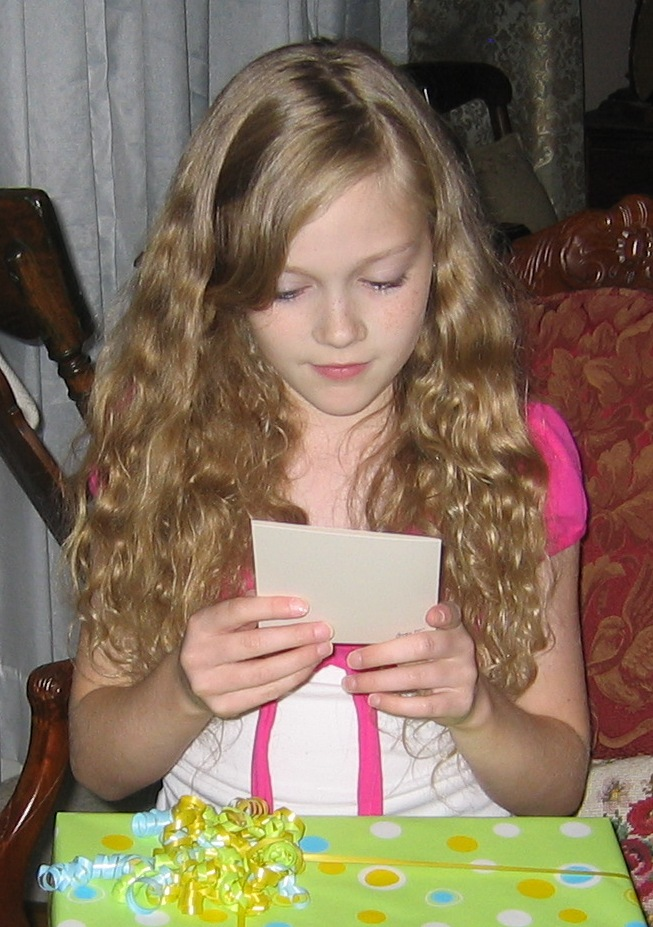 Sammi reading her card